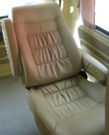 reclining seats with wheelchair storage behind